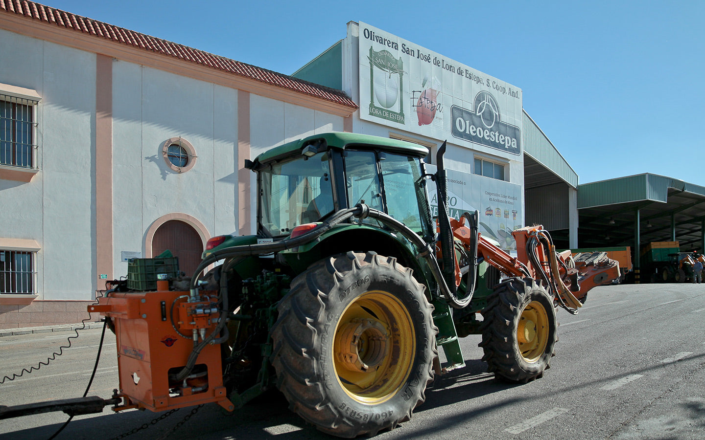 A tractor rolls towards one of the Oleoestepa mills