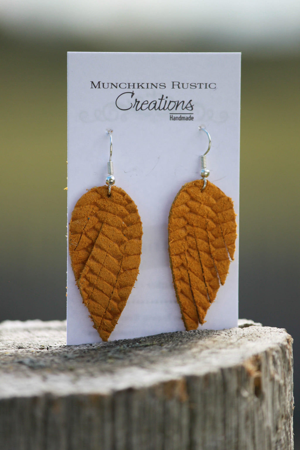 Mustard genuine leather feathered earrings