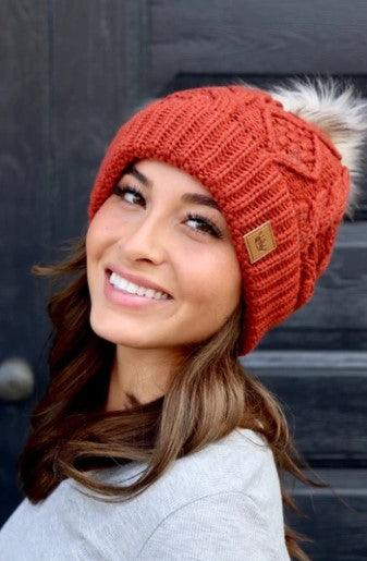 Orange cable knit fleece lined hat with pom