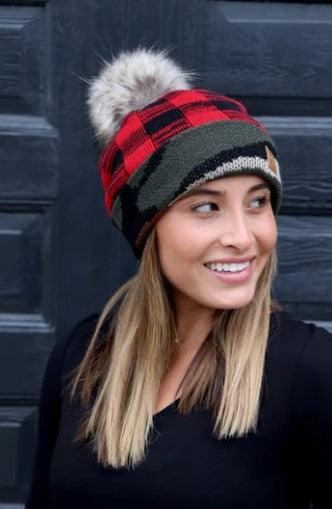 Fleece lined camo and red plaid hat with pom
