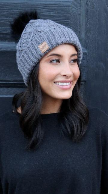 Grey cable knit hat with pom accent