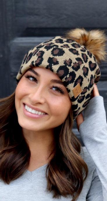 Leopard knit hat with pom accent