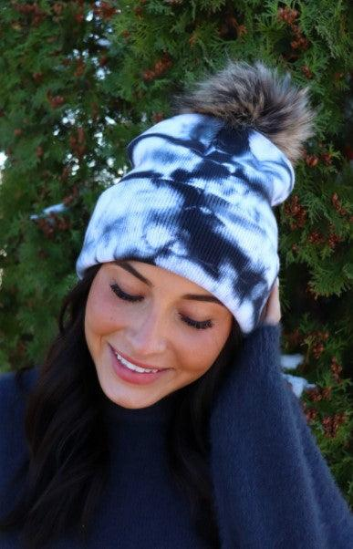 White and black tie dye knit hat with pom accent