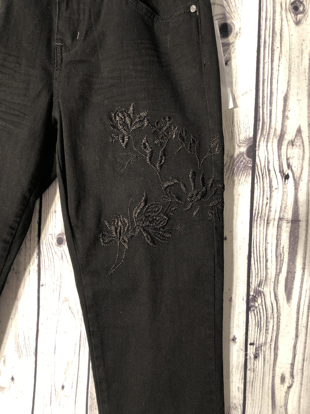 Cream pitch black high waist jeans with embroidery detail
