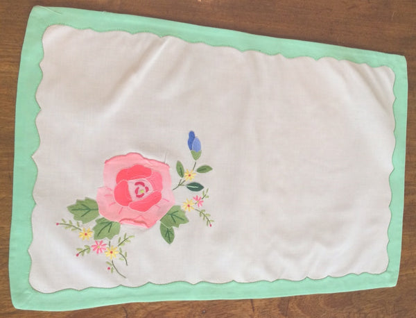 Placemats and Napkins:  Rectangular, white with rose applique and green appliqued scalloped border