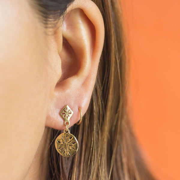Toa Earrings in Golden Brass