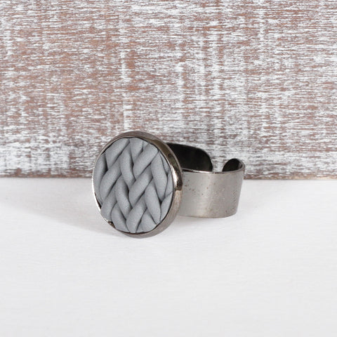 Grey knitted clay ring