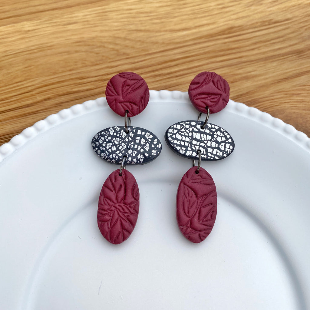 Oval trio drop, burgundy with silver statement earring