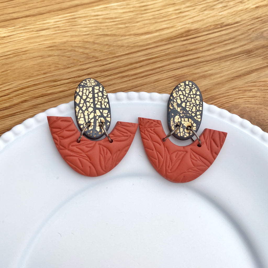 Oval and half donut burnt orange with gold statement earrings