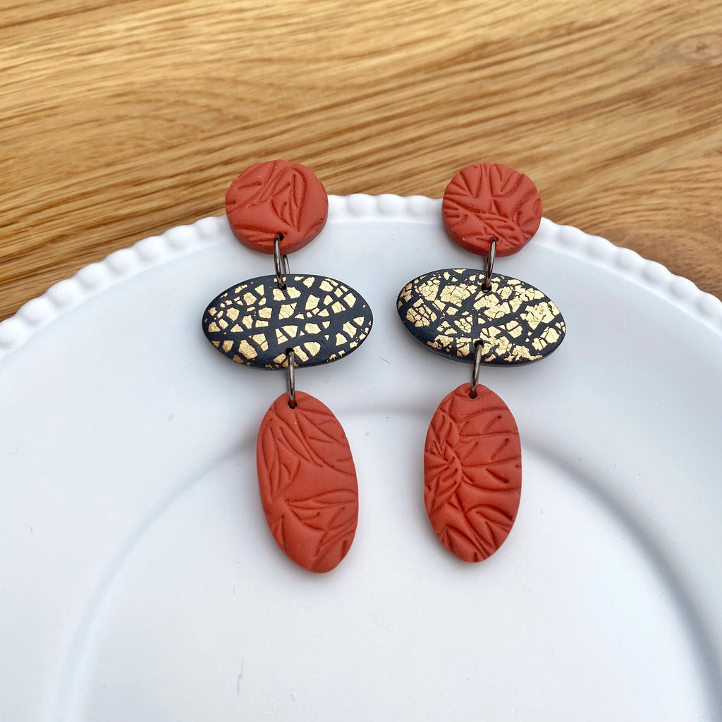 Oval trio drop, burnt orange with gold statement earrings
