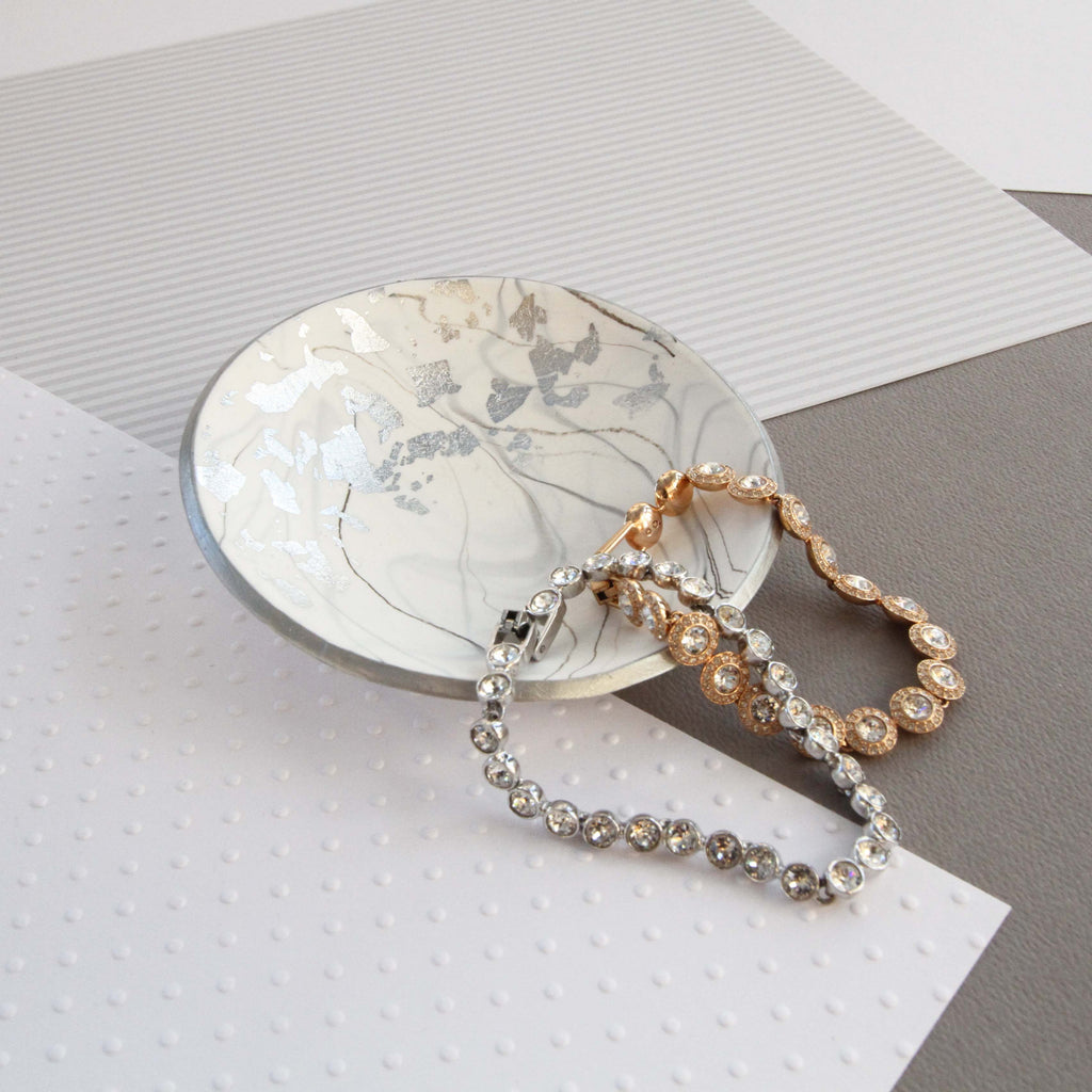 White marble and silver trinket dish