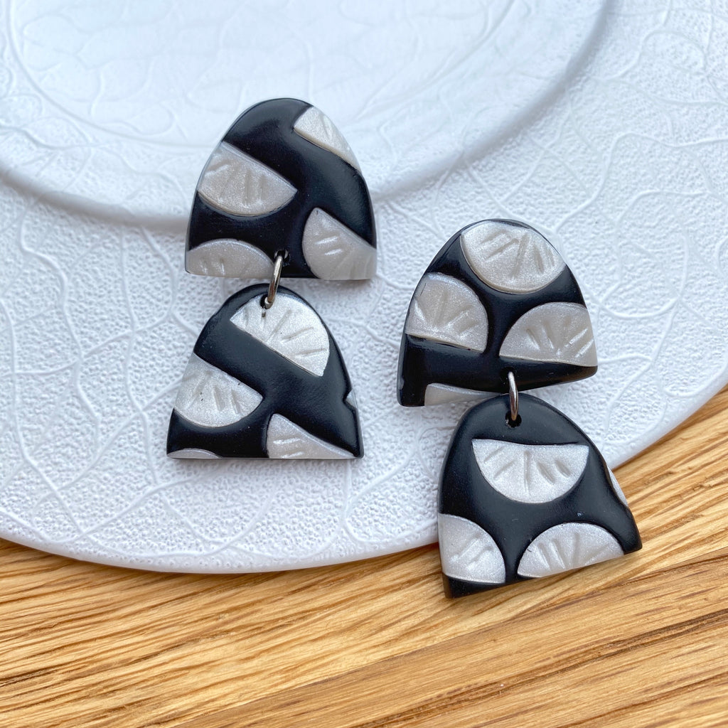Black with pearl segment pattern statement earrings - double half oval drop