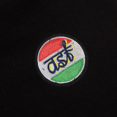 This is a close-up of the A Select Few (ASF) logo from the black lounge pants. The logo is in a circle with orange on top and green on the bottom, which resembles India's flag.