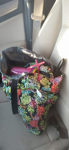 bag inside of a car with items