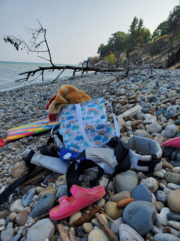 tote on a rocky beach with other items