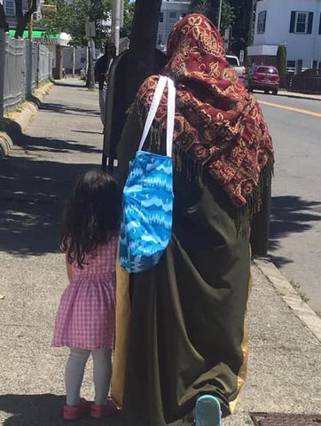 image of adult and daughter with bags
