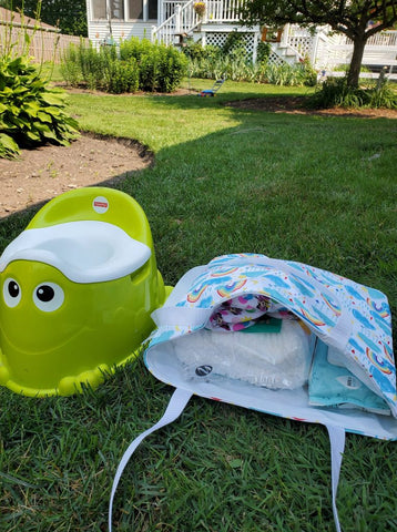 bag in a lawn with toys nearby
