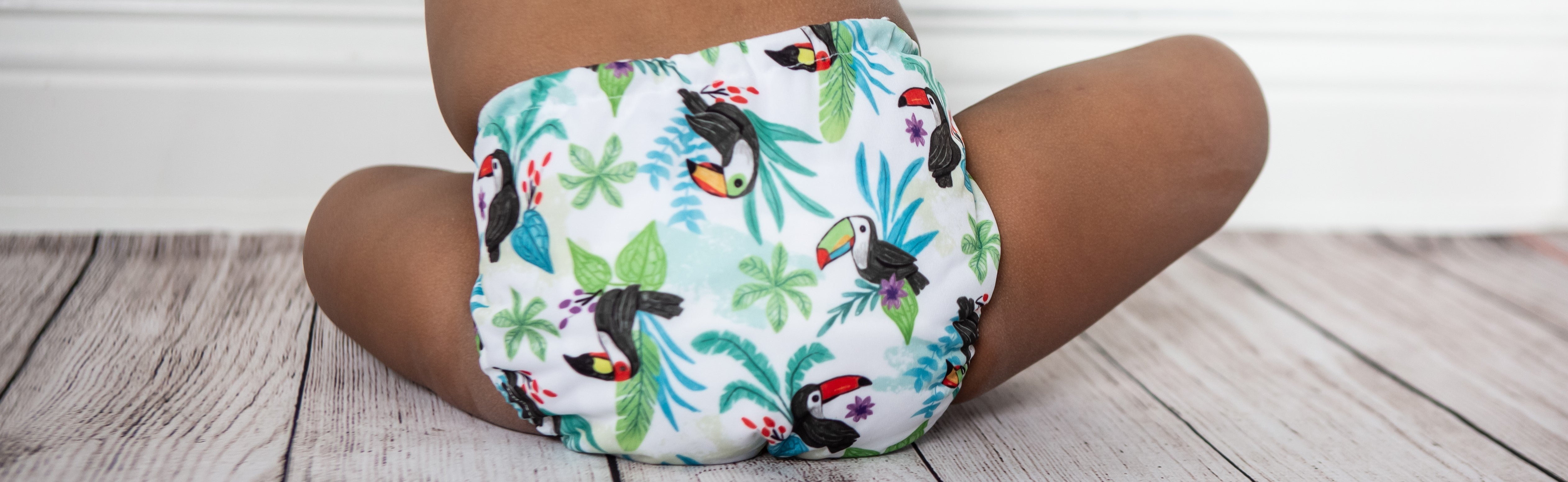 Image of baby wearing Thirsties One Size All in One in Toucan