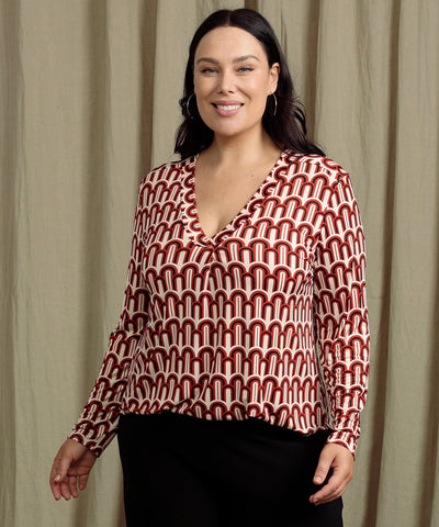 geometric printed tailored top with long sleeves and v-neckline