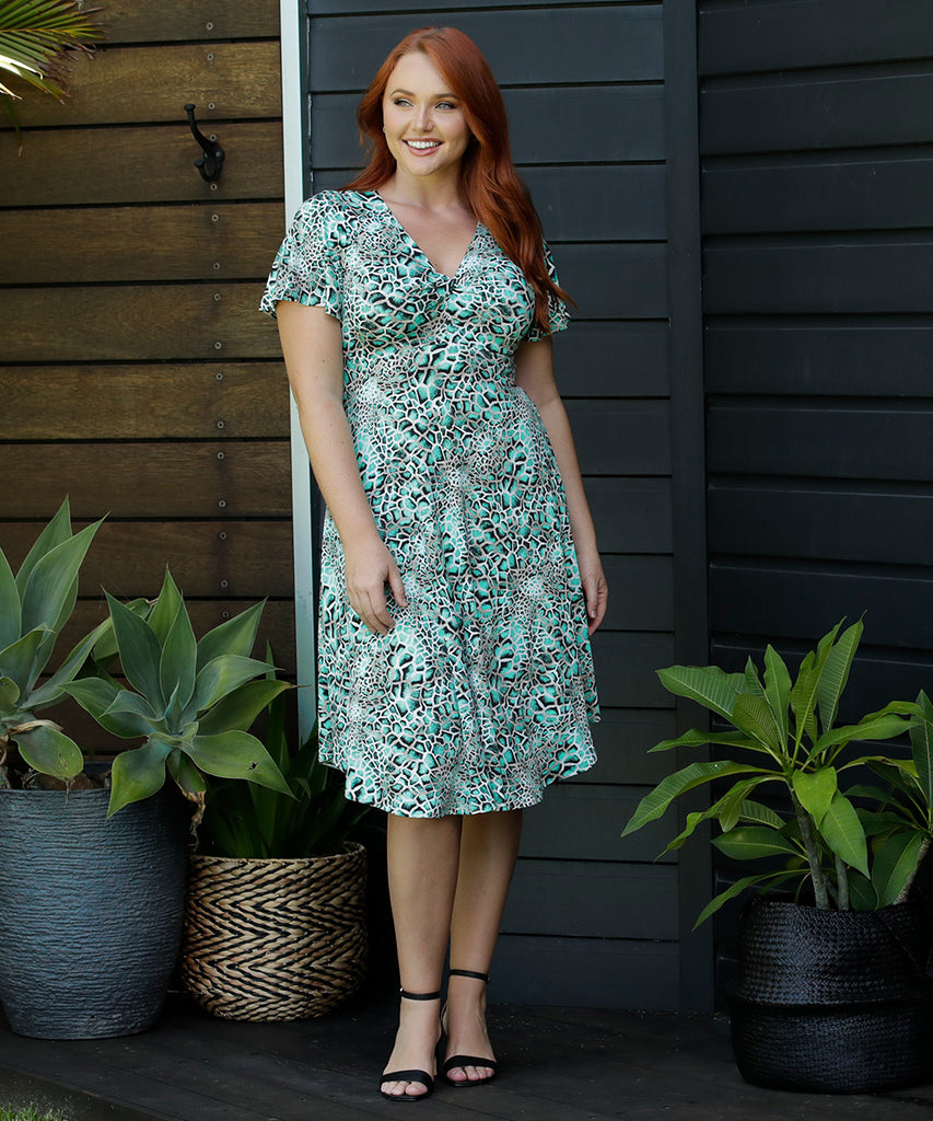 a-line dress with flutter sleeves and twist front bodice