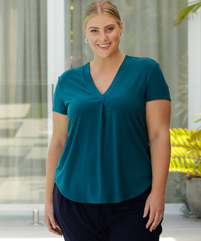 tailored top in dark teal with short sleeves and v-neckline