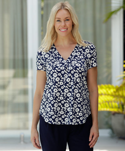 tailored top in floral navy and white print with short sleeves and v-neckline
