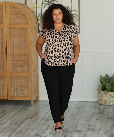 tailored top in animal print with short sleeves and v-neckline