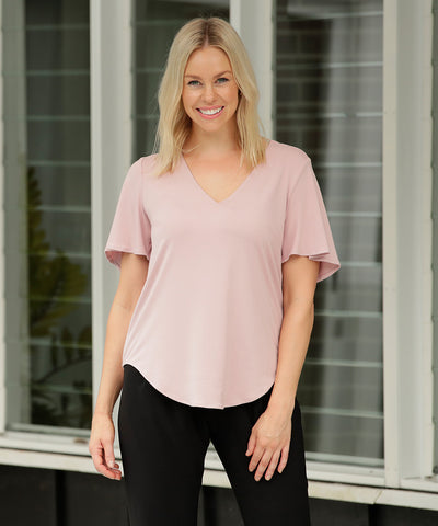 comfortable light pink summer top with flutter sleeves is soft bamboo fabric