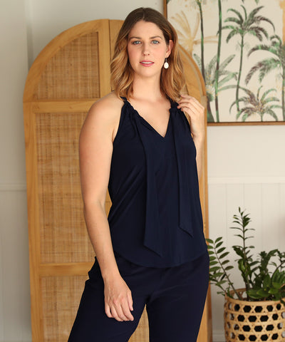 navy halter-neck summer top with shirt-tail hemline