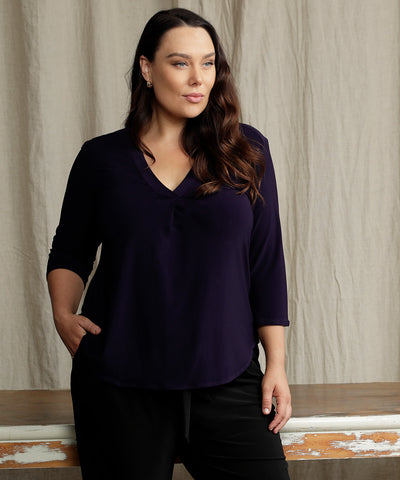 dark purple tailored top in with 3/4 sleeves and v-neckline