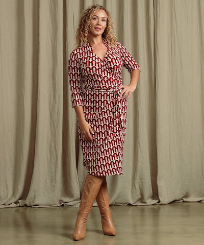 geometric printed wrap dress with 3/4 length sleeves and collar detail