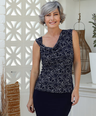 reversible double layer top with a cowl neckline and twisted shoulder detail or boat-neck option in navy and white print