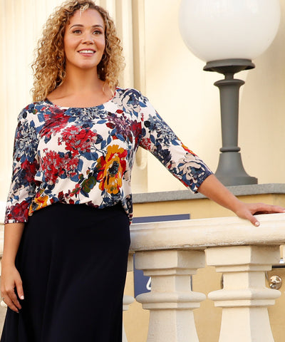 floral top with round neckline and 3/4 length sleeves