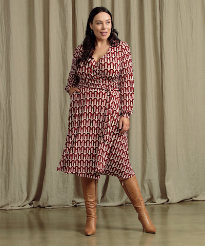 geometric printed wrap dress with long bell sleeves and pockets