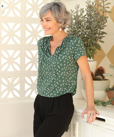 floral print short sleeve top with shoulder gather, neck ties and shirt-tail hemline