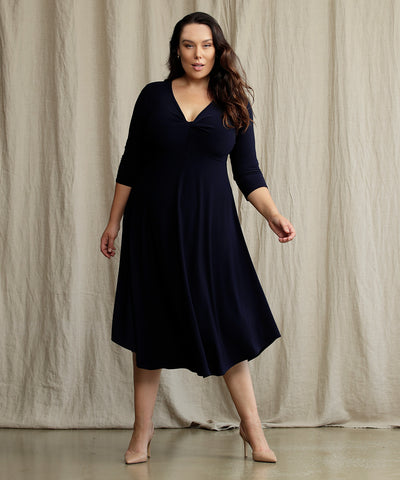 navy empire-line dress with twist bodice and 3/4 sleeves