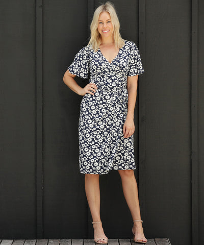 navy and white floral printed wrap dress with flutter sleeves