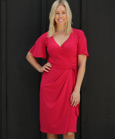 pink wrap dress with flutter sleeves