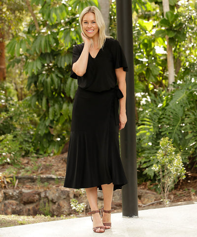 black wrap skirt with extended waist ties and deep ruffle