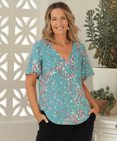v-neck summer top with flutter sleeve and shirttail hemline in floral print