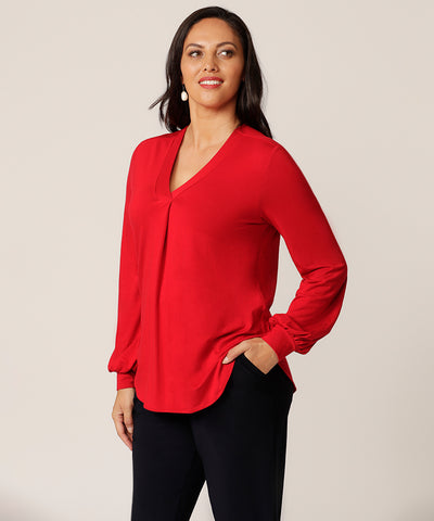 v-neck style long sleeve top with bell sleeves in red