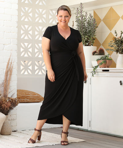 black summer wrap dress with short sleeves and long skirt
