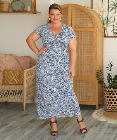 blue and white printed summer wrap dress with short sleeves and long skirt
