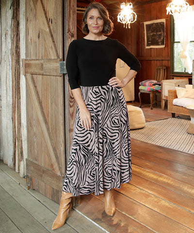 winter maxi dress with black bodice and printed skirt with pockets