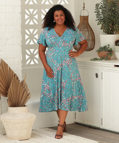floral summer dress with flutter sleeves and twist front detail