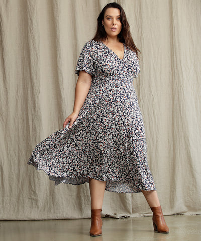 floral a-line dress with flutter sleeves and twist front bodice