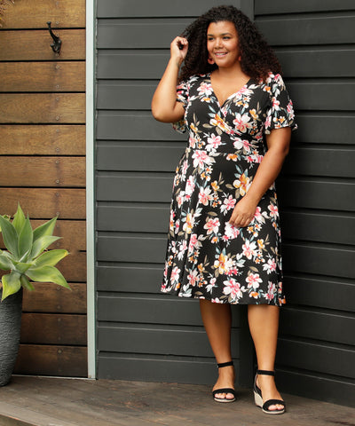 floral fixed wrap dress with flutter sleeves and pockets