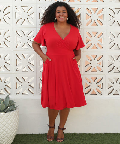 cherry red wrap dress with flutter sleeves and pockets