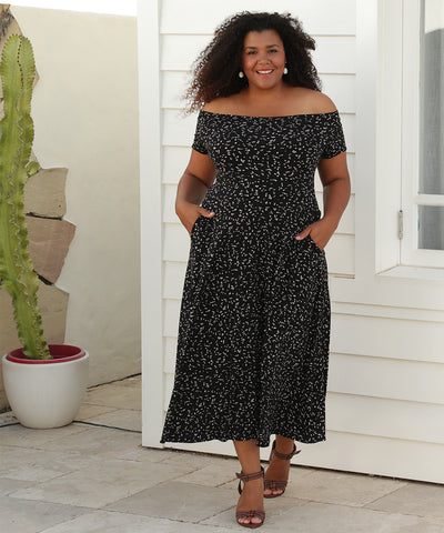 off the shoulder midi length dress with pockets in black and caramel print