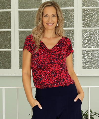 comfortable summer top with soft cowl neck-line and tailored shape in red and pink love-heart print